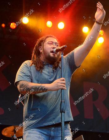 Stock Photo of Reggae singer J Boog performs live at Henry Maier Festival Park during Summerfest in Milwaukee, Wisconsin