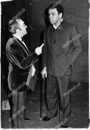 Fleet Street's Number One Boxing Writer Reg Gutteridge (died January 2009): Makes A Point To Muhammad Ali (formerly Cassius Clay). Ali Had Chaired The Talk-in At The New Victoria Theatre In London. Photo By - Roger Allston...
