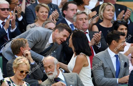 Brian O'Driscoll kisses Honor Carter (wife of Dan Carter seen far right) in the Royal Box