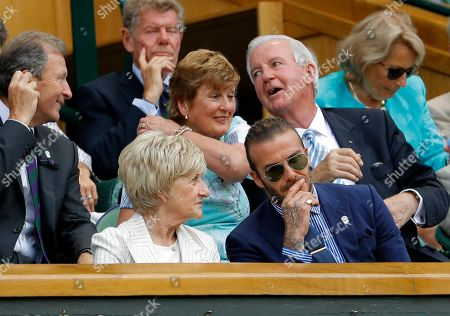 David Beckham and his mother Sandra Beckham watch from the Royal Box on day five at the Wimbledon Tennis Championships in London