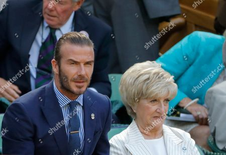 David Beckham, left and his mother Sandra Beckham, sits in the Royal Box on day five at the Wimbledon Tennis Championships in London
