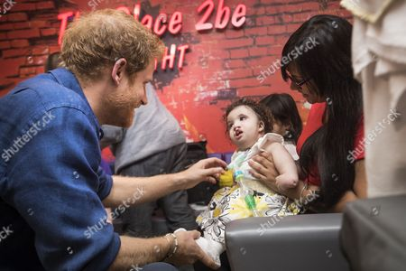 Prince Harry meets Mareyah Joseph-Webster and her mother Sonya Joseph during a visit to Leeds Children's Hospital, on the second day of his two-day visit to the city