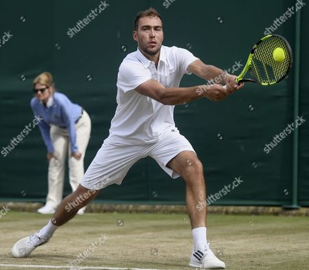 Jerzy Janowicz of Poland in action against Benoit Paire of France during their third round match for the Wimbledon Championships at the All England Lawn Tennis Club, in London, Britain, 07 July 2017.