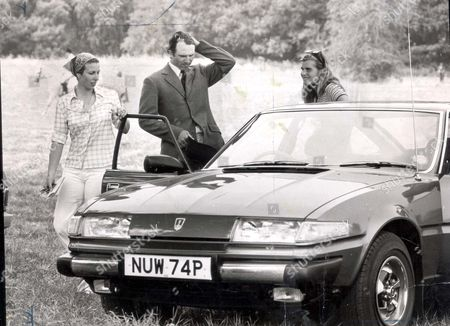 Princess Anne (now Princess Royal) And Captain Mark Phillips. Cars And Driving. Picture Shows The Princess Royal And Mark Phillips With A New Rover Car At The Tebury Horse Show. With Them Is Sarah Phillips Mark's Sister. 1976