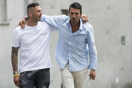 Italian former soccer player Marco Materazzi (L) and Italian goalkeeper Gianluigi Buffon react as they arrive to the Gianni's game, a soccer match with many football legends, in Brig, Switzerland, 07 July 2017.