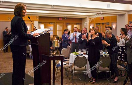Stock Image of Ohio Lt. Gov. Mary Taylor, left, receives a standing ovation from after announcing her candidacy for Ohio Governor at the Republicans at the City Club of Cleveland in Cleveland, . Taylor announced her entry into Ohio's crowded 2018 gubernatorial race Friday, with the promised backing of GOP Gov. John Kasich