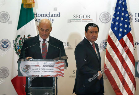 U.S. Homeland Security Secretary John Kelly, left, and Mexico's Interior Secretary Miguel Angel Osorio Chong arrive for a presser in Mexico City . Kelly arrived to Mexico on Wednesday and met with President Enrique Pena Nieto before the Mexican leader departed for France ahead of the Group of 20 summit in Germany. Late Thursday Kelly accompanied military leaders to the southern state of Guerrero, one of the country's primary opium-producing states