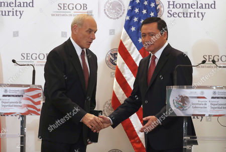 Mexico's Interior Secretary Miguel Angel Osorio Chong, right, greets U.S. Homeland Security Secretary John Kelly after a joint statement at the end of Kelly's visit in Mexico City . Kelly arrived to Mexico on Wednesday and met with President Enrique Pena Nieto before the Mexican leader departed for France ahead of the Group of 20 summit in Germany. Late Thursday Kelly accompanied military leaders to the southern state of Guerrero, one of the country's primary opium-producing states