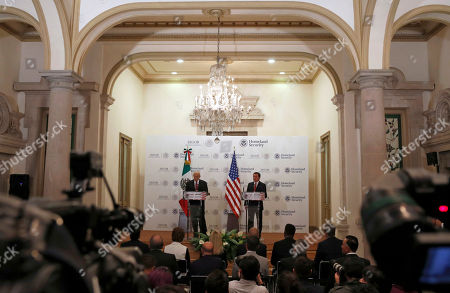 U.S. Homeland Security Secretary John Kelly, center left, and Mexico's Interior Secretary Miguel Angel Osorio Chong give statements after Kelly's visit in Mexico City . Kelly arrived to Mexico on Wednesday and met with President Enrique Pena Nieto before the Mexican leader departed for France ahead of the Group of 20 summit in Germany. Late Thursday Kelly accompanied military leaders to the southern state of Guerrero, one of the country's primary opium-producing states