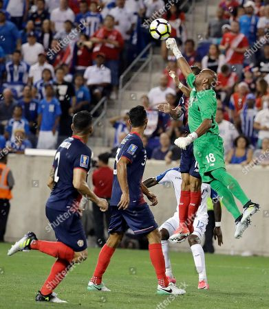 Costa Rica goalkeeper Patrick Pemberton (18) makes a save during the second half of a CONCACAF Gold Cup soccer match against Honduras in Harrison, N.J