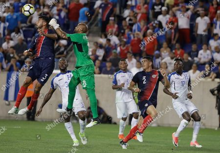 Giancarlo gonzalez, Patrick Pemberton Costa Rica defender Giancarlo Gonzalez and goalkeeper Patrick Pemberton (18) try to stop the ball during the second half of the team's CONCACAF Gold Cup soccer match against Honduras in Harrison, N.J., . Costa Rica won 1-0