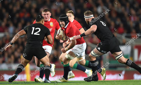 Sean O?Brien of British & Irish Lions takes on Ngani Laumape and Kieran Read of New Zealand.