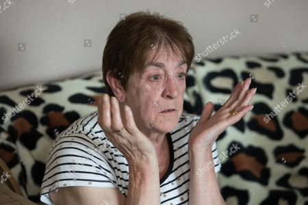Barbara Dransfield reacts as Charles Salvador sings What a Wonderful World to her via Paula Williamson's phone on loudspeaker .