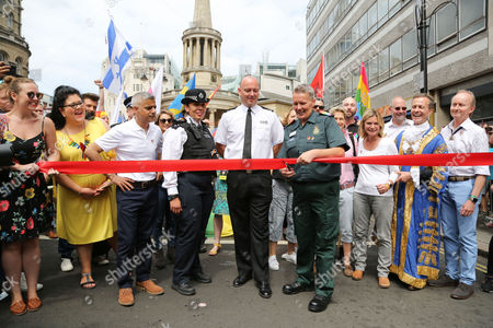 The ribbon cutting. Saadiya Khan, Sadiq Khan, Mayor of London, Justine Greening - Secretary of State for Education, and Minister for Women and Equalities attend the annual Pride London Parade. Over 26,000 people take part in one of the world's biggest LGBT + celebrations.