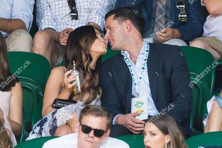 Vicky Pattison and John Noble watch center court tennis on the sixth of the Wimbledon Lawn Tennis Championships.