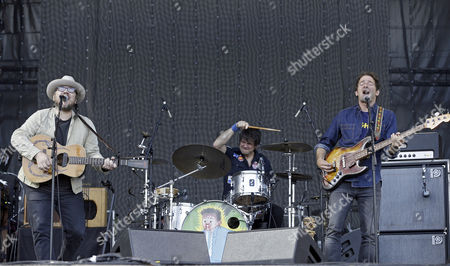 Lead singer Jeff Tweedy (L), bassist John Stirratt (R) and drummer Glenn Kotche (C) of US band Wilco perfom on stage during Mad Cool Festival in Madrid, Spain, 08 July 2017.