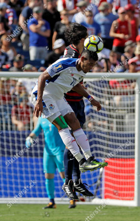 Panama's Ismael Diaz (10) goes up for a header with United States' Omar Gonzalez during a CONCACAF Gold Cup soccer match, in Nashville, Tenn