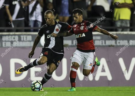 Stock Picture of Flamengo's Trauco (R) vies for the ball with Luis Fabiano of Vasco de Gama during their Brazilian Championship match at the Sao Januario stadium in Rio de Janeiro, Brazil, 08 July 2017.