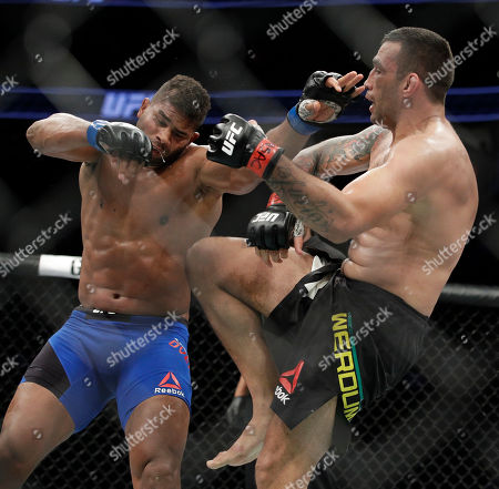 Fabricio Werdum, right, knees Alistair Overeem during a heavyweight mixed martial arts bout at UFC 213, in Las Vegas