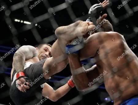 Fabricio Werdum kicks Alistair Overeem during a heavyweight mixed martial arts bout at UFC 213, in Las Vegas