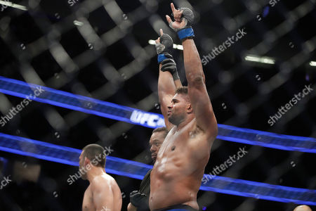 Alistair Overeem celebrates after defeating Fabricio Werdum in a heavyweight mixed martial arts bout at UFC 213, in Las Vegas