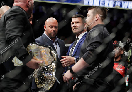 Michael Bisping in the ring after a fight between Yoel Romero and Robert Whittaker in a middleweight championship mixed martial arts bout at UFC 213, in Las Vegas
