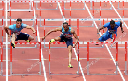 Aries Merritt of USA (centre) jumps the last hurdle before going on to win his 110m hurdles heat.