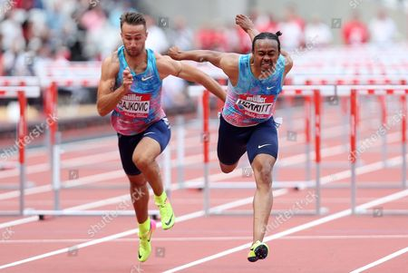 Aries Merritt of USA crosses the line to win the 110m hurdles final.