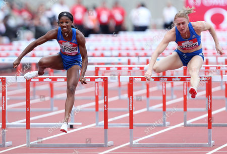 Kendra Harrison of USA jumps the last hurdle alongside Sally Pearson of Australia to go on and win the Womens 100m hurdles.
