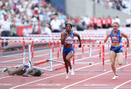 Kendra Harrison of USA heads for the line to go on and win the Womens 100m hurdles as Jasmin Stowers of USA falls behind her.