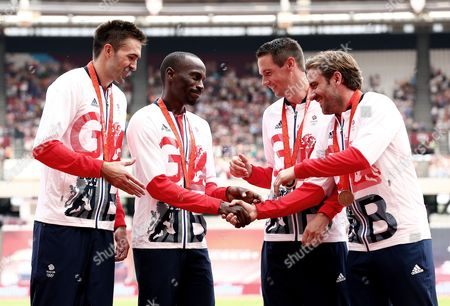 Stock Picture of Martyn Rooney, Andrew Steele, Robert Tobin and Michael Bingham of Great Britain collect their 4x400m relay bronze medals from the 2008 Beijing Olympics.