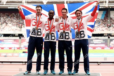 Stock Image of Martyn Rooney, Andrew Steele, Robert Tobin and Michael Bingham of Great Britain collect their 4x400m relay bronze medals from the 2008 Beijing Olympics.