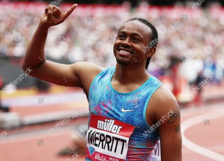 Aries Merritt of USA gestures to the crowd after winning the 110m hurdles.