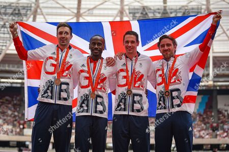 Stock Photo of Great Britain's 4 x 400m Relay team (L-R) Martyn Rooney, Michael Bingham, Andrew Steele, Robert Tobin are presented with their Bronze medals from the Beijing Olympics 2008 during the Muller Anniversary Games at the London Stadium, London