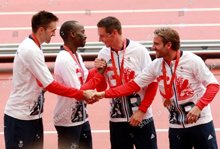 (L-R) Martyn Rooney, Michael Bingham, Robert Tobin and Andrew Steele of Great Britain's 4x400m relay team from the 2008 Beijing Olympic Games receive their bronze medals at the IAAF Diamond League athletics meeting in London, Britain, 09 July 2017. The team was upgraded to third after Russia's relay runner Denis Alekseyev was caught using a prohibited substance when his sample from the 2008 Games was retested.