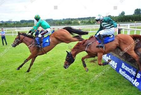 Limerick BAILY MOON & J.J.Slevin jump the last to win the Michael English Steeplechase from THANKS FOR TEA & Paul Townend who survive a very bad mistake to finish 2nd.