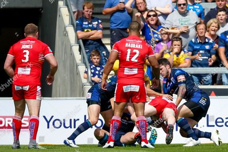 Salford Red Devils hooker Josh Wood (19) goes over for a try during the Super League match between Salford Red Devils and Leeds Rhinos at the AJ Bell Stadium, Eccles