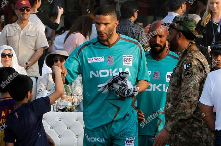 David James Nicolas Anelka England soccer star David James, center, touches fists with a young boy while he along with French player Nicolas Anelka, second right, arrive to play an exhibition soccer match in Lahore, Pakistan, . Former Manchester United and Wales winger Ryan Giggs said he was impressed with Pakistan youngsters' love for soccer after seven iconic footballers, also including Ronaldinho, featured in a rare two-game exhibition series in the country
