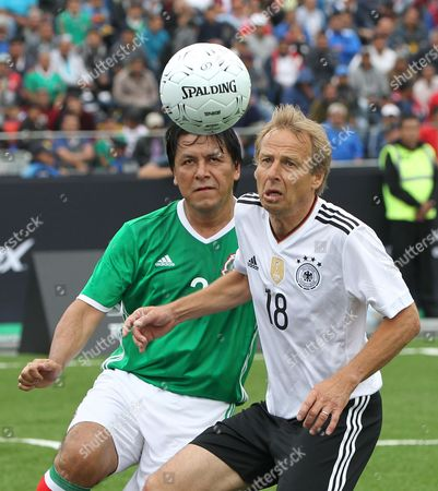 Mexico's Claudio Suarez (L) vies for the ball with Germany's Jurgen Klinsmann (R) during a friendly match to commemorate the 31st anniversary of their 1986 Wolrd Cup match at the Main Square, Mexico City, Mexico, 09 July 2017. 'The Revenge' is a game that gathers the legends from both national soccer teams who played at the 1986 and 1998 World Cups.