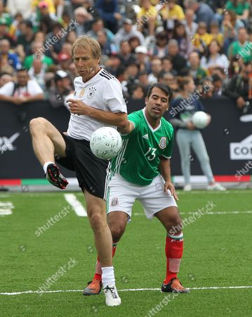 Mexico's Pavel Pardo (R) vies for the ball with Germany's Jurgen Klinsmann (L) during a friendly match to commemorate the 31st anniversary of their 1986 Wolrd Cup match at the Main Square, Mexico City, Mexico, 09 July 2017. 'The Revenge' is a game that gathers the legends from both national soccer teams who played at the 1986 and 1998 World Cups.