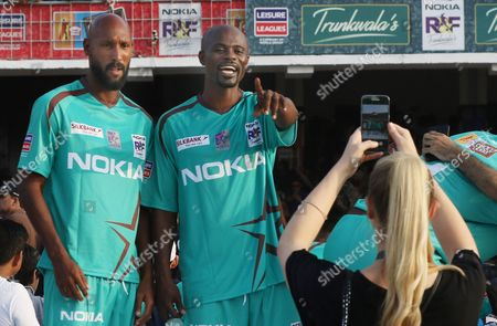 Stock Photo of Nicolas Anelka (L) former French football players poses for a photograph during  a friendly match with Pakistani football players in Lahore, Pakistan, 09 July 2017.  Brazilian star Ronaldihno along with eight biggest soccer stars are on a visit to play two exhibition matches in Pakistan in a bid to bring international sports players to Pakistan.