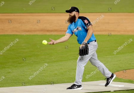 National League's Heavy D pitches during the All-Star Celebrity Softball game, in Miami
