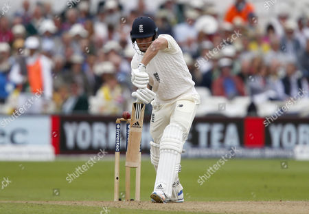 England's Jonathan Bairstow survives a close call as the ball fractionally misses his off stump