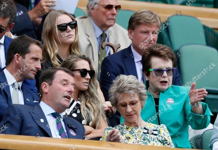Tennis legend Billie Jean King, right, gestures as she sits with Ben Ainslie, second row left, and his wife Georgie, center, in the Royal Box on day seven at the Wimbledon Tennis Championships in London . Top right is golfer South African golfer Ernie Els