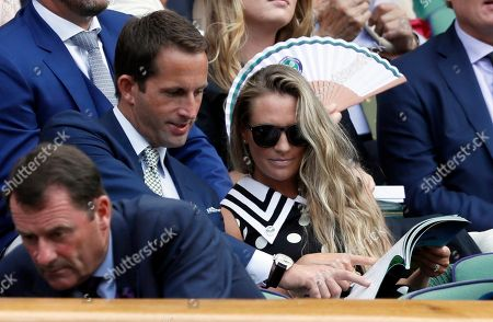 Sir Ben Ainslie, centre left and his wife Georgie sit in the Royal Box on Center Court on day seven at the Wimbledon Tennis Championships in London