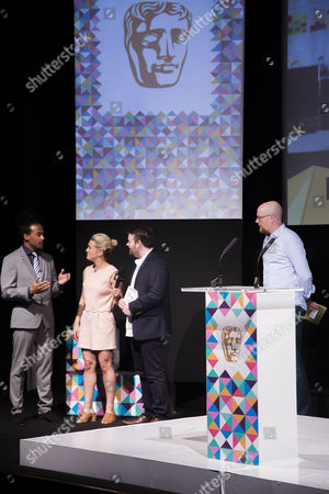Stock Picture of Dev Griffin, Georgie Barrat with Dave Chilvern (winner of the Mentor Award) & Nick Button-Brown (Chair of the Games Committee, BAFTA)