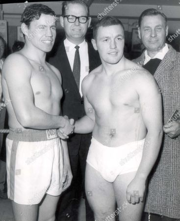 Stock Image of L - R: Boxers Terry Downes Of Paddington And Rudolf Mehring Of Germany Shake Hands After Weighing In For Their Fight At The Royal Albert Hall. In The Centre Is Promoter Mike Barrett.