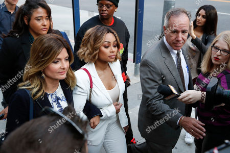 Blac Chyna, Lisa Bloom Blac Chyna, center, and her attorney Lisa Bloom, left, arrive for a hearing seeking a restraining order against her former fiancee Rob Kardashian, in Los Angeles. Chyna has accused Kardashian of cyber bullying and domestic violence over a series of lurid Instagram posts he made last week. The posts got Kardashian's Instagram account shut down, but he continued his attacks on Twitter