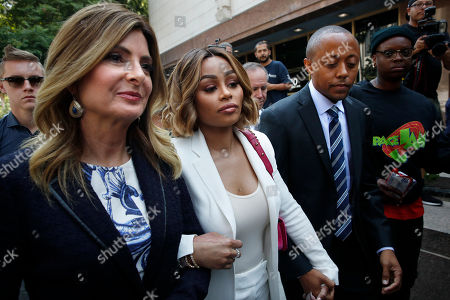 Blac Chyna, Lisa Bloom, Walter Mosley Blac Chyna, center, is flanked by her attorneys, Lisa Bloom, left, and Walter Mosley, as she leaves a courthouse after a hearing, in Los Angeles. A court commissioner has granted Chyna a temporary restraining order against her former fiancee, reality television star Rob Kardashian