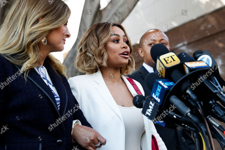Blac Chyna, Lisa Bloom, Walter Mosley Blac Chyna, center, speaks while standing with her attorneys Lisa Bloom, left, and Walter Mosley at a news conference outside a courthouse, in Los Angeles. A court commissioner granted Chyna a temporary restraining order against her former fiancee, reality television star Rob Kardashian